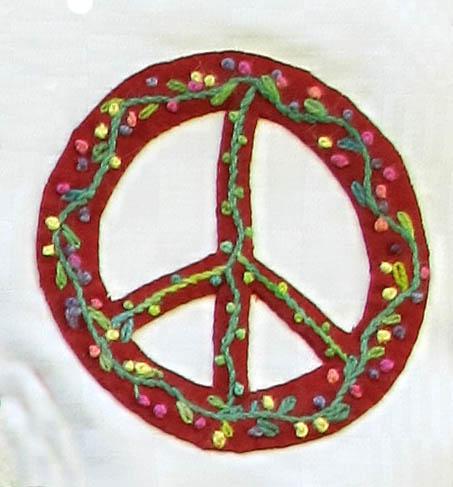 Broderat fredsmärke